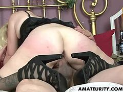 What are you waiting for? Watch this MILF, with a shaved pussy wearing high heels, while she gets fucked in different positions in an amateur video.