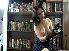 Amazing solo model cougar in black dress smokes heavily before unpinning her dress displaying her natural tits in the library