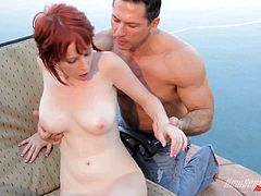 Take a look at this amazing outdoors hardcore scene where the busty redhead Zoey Nixon is fucked by this guy while she wears high heels.