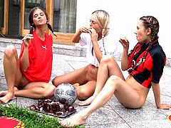 These sexy young babes are all sweaty from kicking the soccer ball around. The two brunettes and blonde Sabrina look sexy in their uniforms, but they soon take then off to head into the water for some lesbian fun. They kiss and lick boobs in the water.