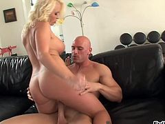 Tattooed oiled cowgirl with shaved pussy sucks a heavy dick passionately before getting its pleasure inside her hardcore