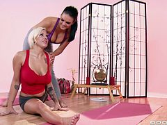 Sporty lesbians Lylith Lavey and Mackenzee Pierce are having a nice time together. The girls explore each other's holes, then poke dildos into each other's butts.