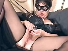 Fat woman om black lingerie and a mask spreads her legs and toys her vagina. She also tests her new toy. She gets her pussy drilled by the Sybian saddle.