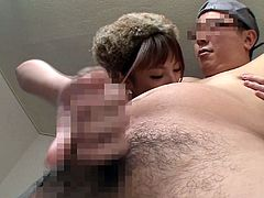 Charming Asian lady with natural tits in miniskirt feeds her horny guy with food before awarding him with a superb handjob