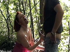 Have fun with this hardcore outdoors scene where the sexy redhead Mina Gorey sucks on a guy before being fucked silly.