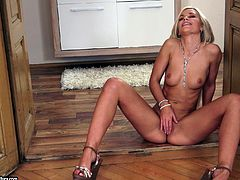 Beautiful blonde with natural tits in high heels showcase her hot ass before masturbating immensely using a huge vibrator