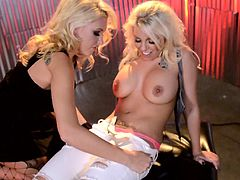 Curvy lesbian babes with tattoos and big fake tits in heels and stockings enjoy finger pussy while muff diving and use toys to fuck