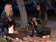 A charming and thrilling scenario speaks about two horny lesbians who need to spend the night in the woods. Chatting by the fire, the blonde babe and the Hispanic lady get rid of clothes and get close to caress each other. See them sucking nipples and licking their pussies. Enjoy!