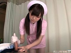 Petite Japanese hussy Aoi Yuzuki, wearing a nurse uniform, is getting naughty with a guy in a hospital. She pleases the dude with a handjob and makes out with him afterwards.