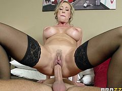 Take a look at this amazing hardcore scene where the busty blonde milf Brandi Love is fucked by this guy's thick cock cock after taking off her blindfold.