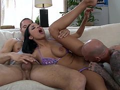 These two guys meet Anissa and her natural tits as she relaxed on the beach in her bikini. They talked her back to their place for a red hot threesome.