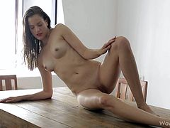 This sexy and skinny sex bomb is looking super hot and sensual today. Her long hair flows down past her shoulders, and she looks at her beauty in the mirror. She shows off her elegant pussy and perfect boobs as she poses by her chandelier.