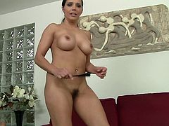 Pretty brunette Francesca Le pulls her thong aside and demonstrates her pussy. Then she kneads her big fake boobs and begins to rub her coochie with a toy.