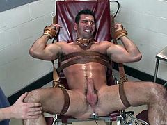 Billy has been strapped on the gynecologist chair with his legs spread. He was tied with leather belts and the guys gagged his mouth and inserted a metal anal plug connected to an electricity source. They've turned on the power and made Billy scream and contract his muscles with pain. Will he cum too?