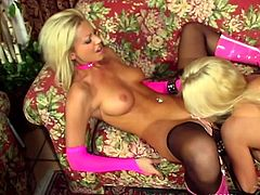 A gorgeous blonde lesbian with long hair, big beautiful tits and a great body enjoys getting her shaved pussy licked and fingered.
