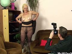 It all started pretty casual. The dude saw his mother-in-law in the living room, looking pretty hot, with her black dress and nylon on. He has just bought a new camera, so he suggested that he takes a couple of photos. He almost freaked out when she started cavorting around, showing off her gems - literally! Watch the old bitch pull her dress down for a special picture. When she was wearing nothing apart from those nylons, it was too late to stop. She ate his load, and later his wife found the naughty pictures!