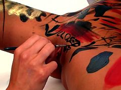 Kiki and her lesbian lover are having some kinky fun with body paint. The girls cover themselves in the paint and write messages all over each other's body. Kiki gets writing all over her inner thighs and her cunt. These lesbos love to get dirty with each other.