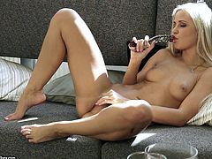 Beautiful blonde with natural tits in miniskirt finishes reading a magazine and start masturbating passionately using a sex toy
