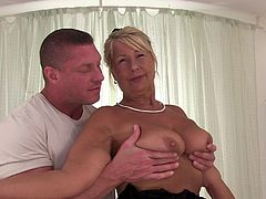 Have a look at this hot scene where the mature blonde Dillon A shows off her big natural tits before being fucked silly by this guy and ending up with a warm creampie.