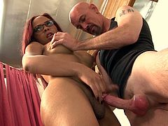 Redhead shemale with fake tits in glasses enjoys her cock being given blowjob before getting her anal drilled hardcore indoors