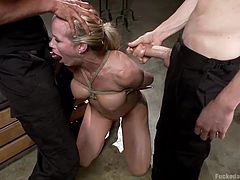 Simone is a naughty blonde that likes it rough so the boys tied her up and stuffed her pretty mouth with cock. After she sucked it hard and deep they've double penetrated her, stretching her pussy and making her moan with pain. That's what she deserves for being a whore!