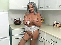 sexy april in the kitchen with yoghourt in the big pussy