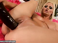 Blonde Sheila Grant satisfies her sexual desire alone in solo action