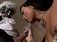Natalie X is a gorgeous, long haired Asian, who's dressed in her medieval costume, while an anonymous masked man is ravishing her ample breasts, until her nipples harden. Next, you'll see a close up of her giving him a deep-throat blowjob. After laying on her bed with her panties off, allowing you to see her stockings, shaved pussy and after a wet blowjob she gets a facial.