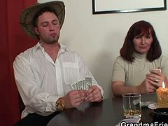 These two guys made sure this old redhead would lose at poker and end up taking their cocks. She played along and got banged from both ends at the same time.