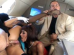 Yasmine gets a neckless from Lauro. While she admires her present, Sarah the stewardess appears. James is looking at Sarah and she sits herself on his lap. He touches her breasts and slips his hand in her panties. It doesn't take long or the real action begins between the two of them. Meanwhile yasmine shows her gratitude for her present and begins to suck Lauro's dick. We see a hot foursome becoming reality for them and before the plane touches the ground the women make sure that the men shoot their sperm out of their peckers.