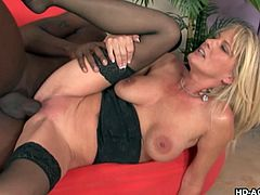 Striking blonde Milf enjoying the pleasure gives by a huge black cock. Looks incredible to see his huge thing grinding and thrusting her hungry pussy getting it so wet.