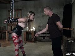 This sexy blonde has a gentle master who only spanks and whips her for a short while. His gentle torture leads to fucking her pussy from behind, fact which she is grateful for.