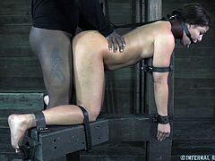 Mia is about to get drilled, no, not by that drilling machine but by a big black cock, her executors! She's taunted and teased but then things get a bit more serious and the black guy approaches her from behind and begins to rams her pussy with his black dong. Being tied and humiliated, Mia takes it like a champ!
