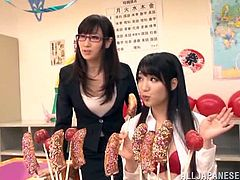 These cute Japanese teens are trying out all this delicious candy treats. The candy treats are shaped like penises which naturally makes them so horny. They find their male friend so they can plays with his cock and give him a blowjob. They lick his nipples to turn him on.