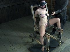 Bella is a whore and that's how we like her! She's tied tight on that chair, blindfolded and with her mouth opened wide with a simple metal device. The executor approaches her, whips her pussy and then he uses and inflatable dildo to fuck her. He slides it in her lubed snatch and inflates it some more.