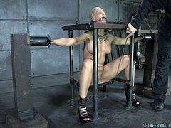 Blonde slave Simone has been locked in the shackles by her master. She has her nipples clamps and pantyhose put on her head. The master puts clamps on the slaves lips and cheeks and stretches open her mouth hole so her tongue can be clamped down.