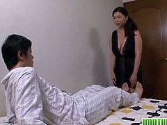 Busty MILF Sayuri Mikami seducing this younger guy by going into his room crawling towards her holding her cock and giving him a nice blowjob. The fun starts after that as she was fucked while holding her huge tits.