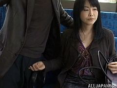 Amazing Asian cowgirl with long hair enjoys her hairy pussy being fingered immensely by a horny gentleman in a public bus