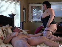 This fat milf is looking amazing in her lingerie. Her man sucks on her massive boobs and eats out her delicious cunt. The fat bitch climbs on top of him to suck him off in the 69 position. She offers plenty of cushion for when he fucks her hard.