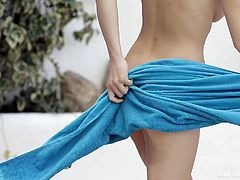 This cute girl is wearing nothing but a bikini bottom as she gets into the water. She was relaxing and drinking wine in her jeans shorts. After cleaning the water with the skimmer she takes a dip and splashes water on her gorgeous natural breasts.