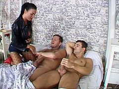 This slutty brunette loves to take a huge cock in her mouth for a suck in a hot blowjob while her shaved pussy gets a hardcore fuck by the other.