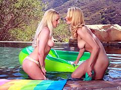 The video surprises a lesbian couple in intimate love making kinky scenes. The two blonde babes come out from the water after a relaxing swim and begin caressing and kissing. Click to watch them licking tits and eating pussy with enthusiasm and sheer passion. Enjoy the details!