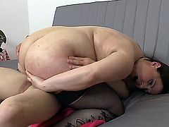 young guy is trying on his sweater and gots fucked by this chubby mature.