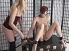 Dominate lesbian spanks masturbates and toys her submissives asshole