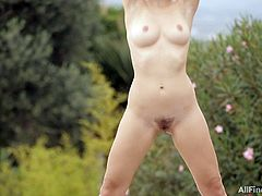 This sexy slut is dancing by the garden. She is such a tease. Watch as she takes off her tight yoga pants to reveal her precious cunt. She has beautiful small boobs that she loves to shake. She thrusts her hips powerfully and shows off her cute butt.