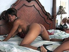 Two sweet ebony babes wearing high heels indulge in raunchy oral sex. Later on they fuck one another with a big fat dildo.