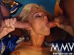 Kelly Trump is a busty German whore who wishes for something and two genies appear to fulfill her wish. She takes both their cocks simultaneously and their loads as well.