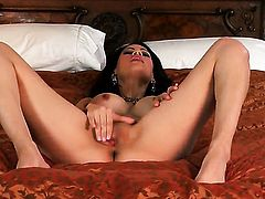 Vanessa Veracruz with giant tits and smooth pussy has fire in her eyes as she rubs her fuck hole