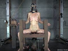 This slave is dominated and humiliated by her cruel mistress. The slave has to turn the crank on the torture device and when the bell rings, she gets a mean shock. The mistress roughly grabs those boobs and slaps the slave's chest. Mean mistress want to put electrodes on her her lobes next.