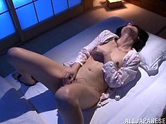 Provocative Asian amateur solo model with small tits in thong moans in ecstasy while ravishing her hairy pussy in a hot masturbation action